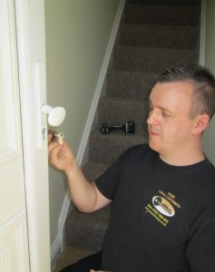 Locksmith performing a lock upgrade