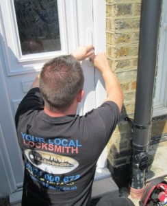 Locksmith picking open a door lock